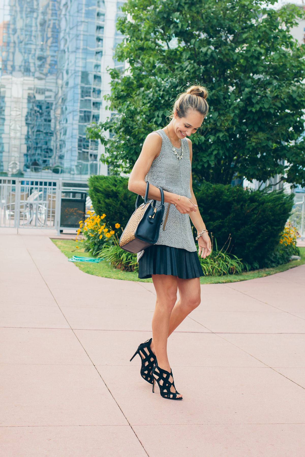 knitted tank, faux leather skirt and a leopard bag — via @TheFoxandShe