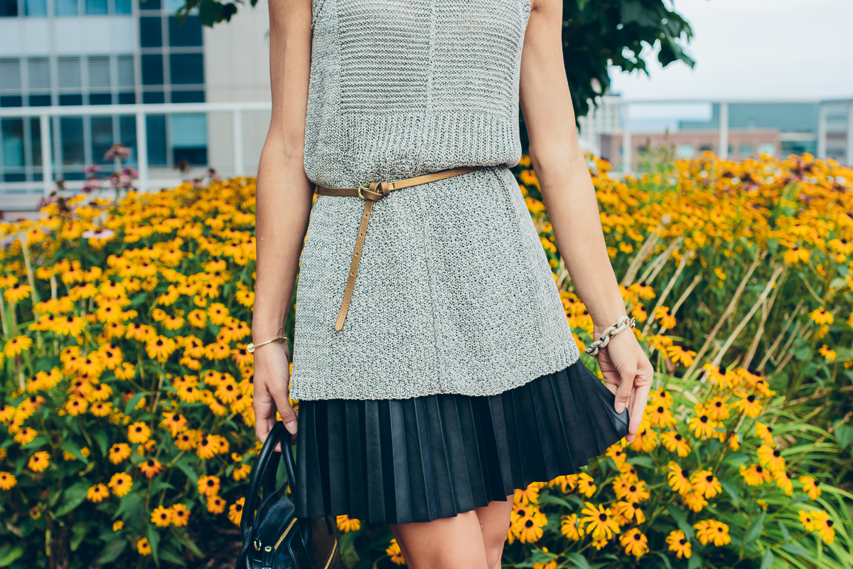 knitted sweater tank and pleated leather mini skirt — via @TheFoxandShe