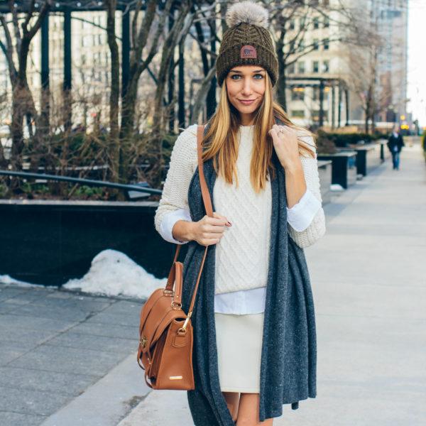 winter whites, camel bag, cable knit sweater, pom pom beanie —via @TheFoxandShe