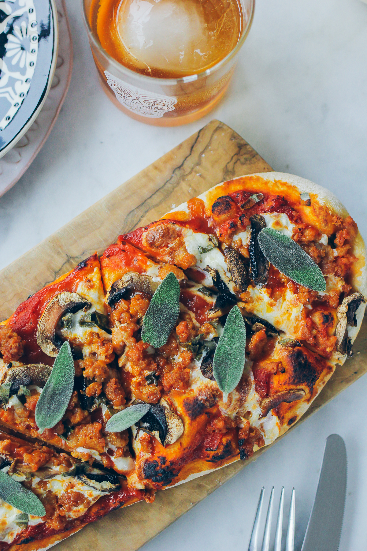 sausage and mushroom pizza with sage — via @TheFoxandShe