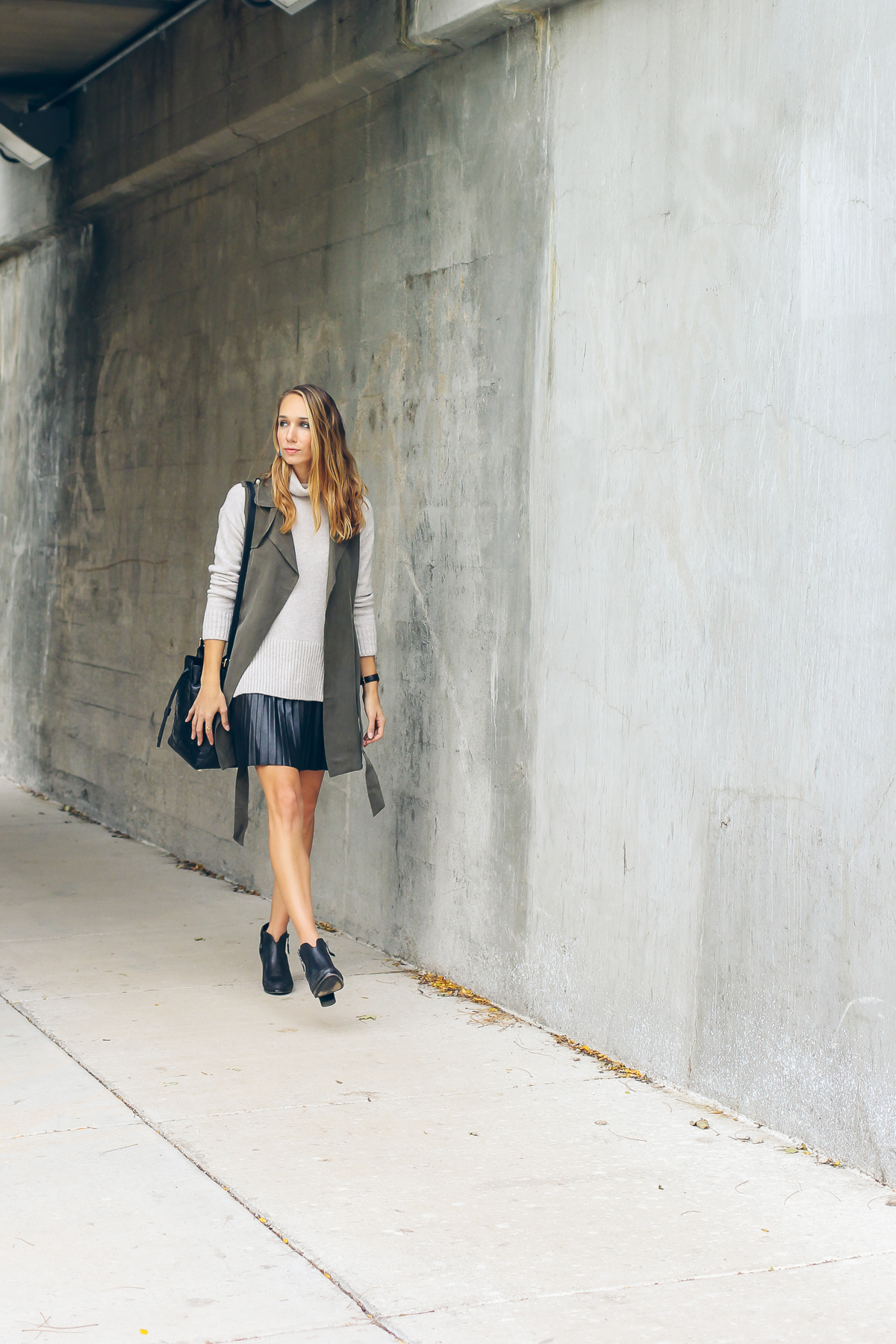 trench vest, pleated leather skirt, chunky knit sweater — via @TheFoxandShe