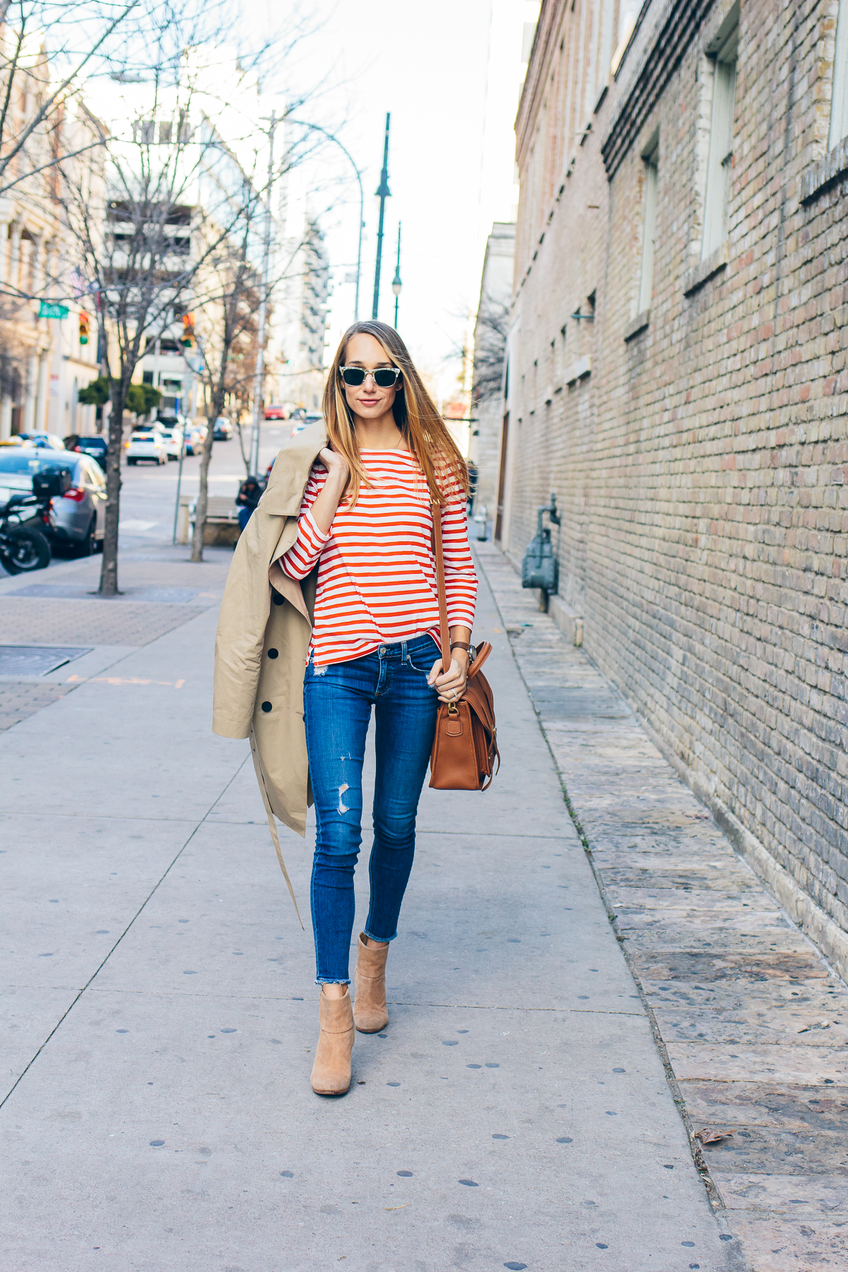 striped tee, trench coat, distressed jeans, tan booties, casual outfit, everyday outfit — via @TheFoxandShe