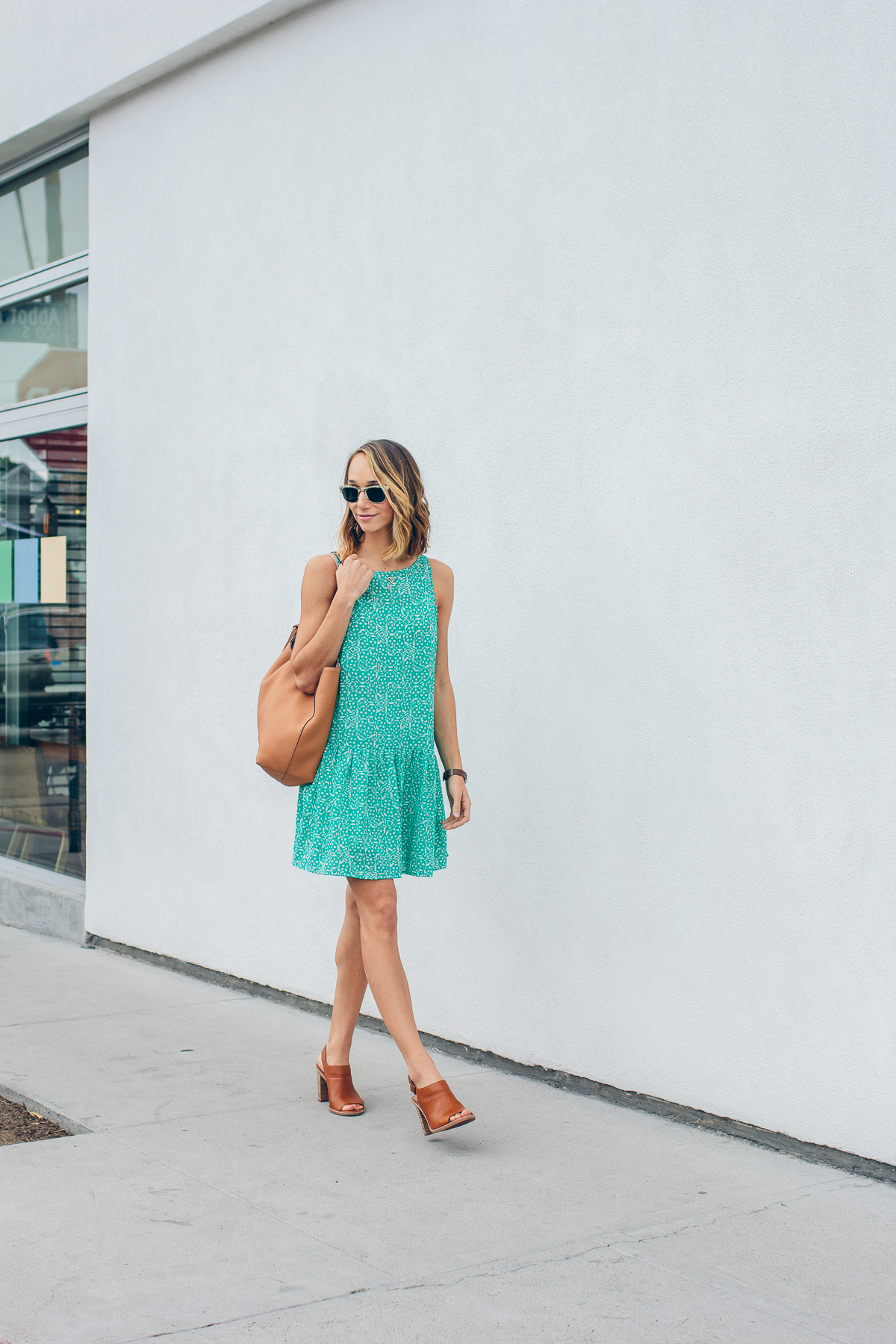 cupcakes and cashmere dress, drop waist dress, tan mules, summer outfit, tassel tote bag — via @TheFoxandShe