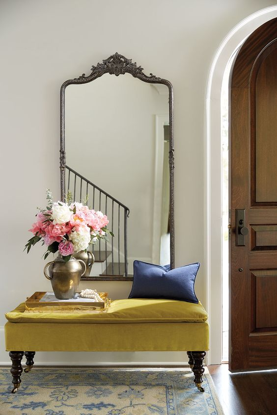velvet bench in entryway with roses — via @TheFoxandShe