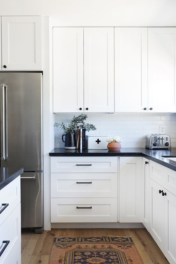 Inspiration & Ideas for Our Kitchen Renovation | black countertops and white cabinets